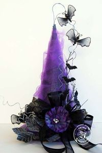 Glammed up Witch Hat! From photo - spray styrofoam cone black, wrap with purple tulle and add black bow and leaves with a purple flower and wire on spooky details with picks and garland found at stores such as Michaels - I'm making this for Halloween ...