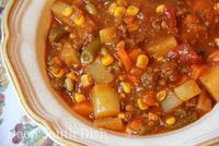 Hobo Stew, made with ground beef, potatoes, carrots, corn, green beans, beef stock, diced tomatoes and V-8.