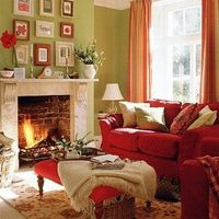 The green walls and the red couch give the room a complementary scheme.