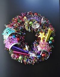 Cute wreath for New Year's Eve party. Would be classier with silver black and gold