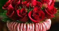 Stretch a rubber band around a cylindrical vase, then stick in candy canes until you can't see the vase. Tie a silky red ribbon to hide ...