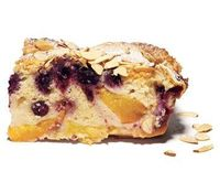 Old-fashioned cake meets summer's juiciest fruits. Who wants seconds? Get the recipe for Peach and Blueberry Buckle.