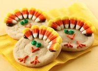 Turkey sugar cookies! Candy corn for the feathers and M&Ms for the eyes!