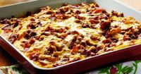 Simple Breakfast Strata I made it with eggbeaters and then added 2 regular eggs, and 1/2 cup extra milk, this makes a 8x8 pan. 6 pieces 141 cal each whole pan is 850 calories when made with low fat cheese and low cal bread. Very good and it's filli...