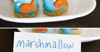 Playful Goldfish Inspired Pool Party: fish marshmallow pops with graham cracker sand, sea character cake, pinwheels & goldfish snack bowl.