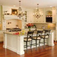 Definitely want a big kitchen island. I love the chandeliers too!
