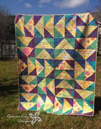 """Create a masterpiece when you take on this Huge Flying Geese with Layer Cakes Quilt. You will use 10"""" precut squares or layer cakes and some yardage to assemble"""
