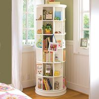Omg. A revolving bookcase (this one's from Pottery Barn) is a great solution for a small space. I love it!