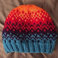 This quick pattern uses stranded knitting to blend four colors. Finished�€�
