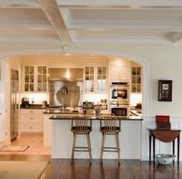Adding overhang space to a kitchen counter is an easy way to make bar space. The overhang can be a rectangular extension or a semi-circle shape. You can use a t