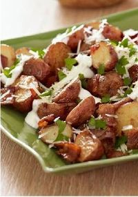 "Roasted New Potatoes �€"" Mayo, lemon juice and garlic combine for a topping, while bacon and cheese up the yum factor. This side pairs great with an Easter dinner!"