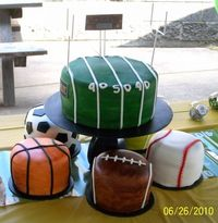 sports theme centerpiece ideas | This couple loves sports and had a sports themed wedding reception