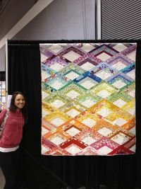 grumpystitches: Awesome! carolinaanne: Me with my quilt at the NW Quilting Expo!