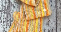 I've decided that I want to crochet something similiar to this since I'm not a knitter. On second thought this may just be the time to take up knitting. This scarf is adorable!