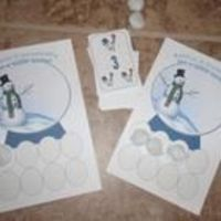 Hand each child a playing board. Put the pom-poms (snowballs) in the middle of the table. The adult holds the playing cards. Students take turns ta...