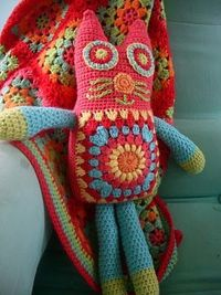 Great use of Granny Squares in the kitty! I love the colors in the blanket & kitty !