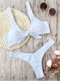 PRODUCT DESCRIPTION In a solid color hue, this two piece bathing suit feature a cute front tied design, with a padded bust lining. Matching high cut bikini bottoms will flatter your curves with its minimal coverage over the buttocks. Swimwear Type: Bikini...