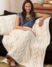 The large, chunky cables in the Twisted Taffy Throw and Pillow will make this classic afghan a favorite of the whole family. With the cold nights of winter on t