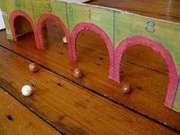 Troll My Dame. This is a marble game which you play with targets. It's one of the games children played at Plymouth Colony, the early English settlement in North America.
