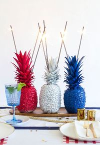 How to make simple and patriotic 4th of July Pineapple Sparkler Centerpieces with only 3 supplies.