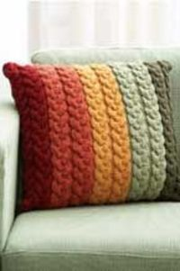 Knitted Cable Pillow. Pattern is in Paton's Next Steps Six - Learn to Cable book. $4.95 for 10 easy to intermediate patterns in the book. I really like this pillow pattern.