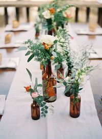 Wine bottle centerpieces become more popular by the day. You would expect to see wine bottles at a wedding but not the way we picture them. Forget about the con