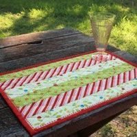 Holly Jolly Quilted Placemats - two 2.5 by 18.5 of 3 colors, flip & sew quilt has you go & bind. Love it for a family gift