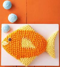 Tropical Fish Birthday Cake: This would be perfect for an aquarium or ocean themed party.