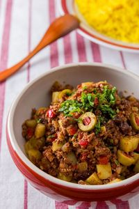 Cuban-Style Picadillo is a beef hash with potatoes, raisins, and olives. Redolent of warm spices like cumin and cinnamon, it's easy to make and delicious.