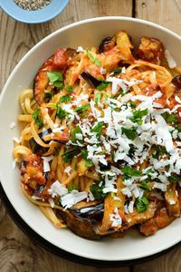 This traditional Sicilian pasta dish of sautéed eggplant tossed with tomato sauce and topped with ricotta salata makes for a satisfying vegetarian dinner, and i
