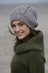 How to Make a Slouchy Beret Using a Round Loom. A slouchy beret can be knit using a round peg loom, which can be purchased at craft stores or through online mer