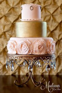 Pink and gold wedding cake with fondant roses