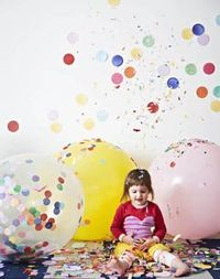 jumbo confetti balloon also ice cream note pad (like sticky notes) stuck to the wall---probably a pretty easy way to decorate for a fun atmosphere, could do heart shapes too