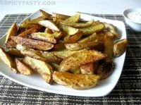 Oven baked potato wedges - Eric, you MUST make these!! (I didn't use the butter, rosemary, or white vinager cuz I didn't have any, so, so good!)