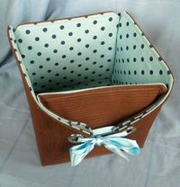 I've been doing some experimenting building baskets and boxes out of fabric. I have a lot of grommets and a few grommet tools. I had an idea for a box/basket an