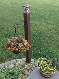 Do it yourself lamp post, with hanging basket. One 4x4 post, concreted in ground, hanging basket bracket, solar light on top. Stain post and done!! EASY!