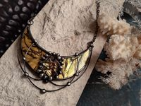 Golden Crescent Moon Pendant with bismuth crystal. Luxury and wealth materialized in our moon necklace. $63.00