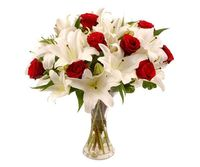 This is stylish bouquet is bursting with scented white lilies and red roses; the brilliant colour contrast speaks of passion and drama. These are perfect flowers to send to someone special as a romantic gesture at any time of year but with the simplicity ...