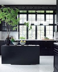 black cabinetry + while tile floors // kitchen design #interiordesign #kitchen
