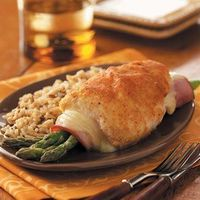 Asparagus-Stuffed Chicken Rolls Cut out the breading, use a reduced fat (or smaller portion size) cheese and ham, then it becomes a more healthier version. As is...almost 500 calories just for the chicken portion!