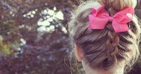 Upside down braid with a messy bun and pink bow by hairfashion1433.