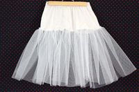 """To give your skirts and dresses some """"Rockabilly"""" dimension, sew a tulle crinoline using a slip and tulle to wear underneath."""