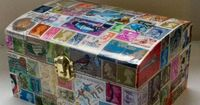 Postage stamp-covered box. DIY for all those loose stamps from my collection. Better than sitting in the attic.