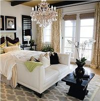 Love the painted black wood, white & grey carpeting with gold drapery and decorative pillows. carpeting with gold drapery and decorative pillow.