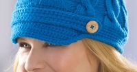 Newsy Cabled Cap Knitting Pattern | Red Heart