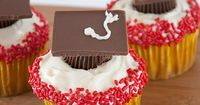 Such a cute idea! Reses pb cup upside down on a cupcake and with frosting as glue put a chocolate square on top, add some frosting for the tassel and ta da!:)