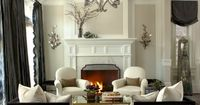 Beautiful family room. Note how the light room has dark accents like curtiains and furniture borders.