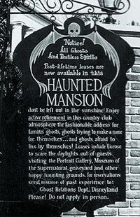 Sign announces the imminent opening of Disneyland's Haunted Mansion.