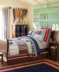 sports room - if I'm lucky enough to have a boy one day...vintage baseball will be his theme. I like the score board, flags and blue storage buckets from this room.
