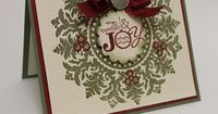 """Christmas Wreath Medallion Card. A friend of mine did something similar, but she put red rhinestones on as """"berries"""". Another good idea for the berries is red pearls or use """"Liquid Pearls"""""""